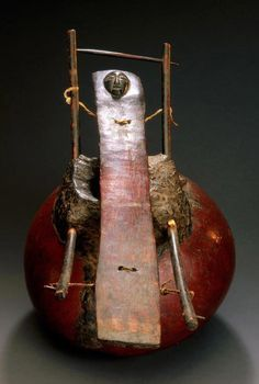 Africa | One key xylophone from the Luba people of the DR Congo; wood, gourd, resin, hide and fiber