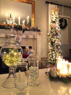 Apothecary jar from HomeGoods with lights and ornaments make for a spectacular centerpiece on any table. (Sponsored pin)