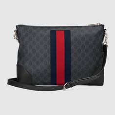 Shop the GG Supreme messenger by Gucci. A flat messenger bag with removable shoulder strap, made in GG Supreme canvas in a black/grey combination. The GG motif is further enriched with a Web stripe detail down the center and black leather trims. Gucci Messenger Bags, Small Messenger Bag, Supreme, Gucci Fashion, Canvas Shoulder Bag, Gucci Shoes, Gucci Black, Luxury Bags, Canvas Leather