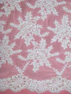 """AL0265 BL White Allover reembroidered floral lace with detatchable 2"""" trim border. With sead beads, pearls and french crystal clear seqins. 56"""" wide."""