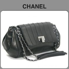 """AUTHENTIC CHANEL HANDBAG Authentic black calfskin handbag with SHW. The bag has silver heat stamps, burgundy leather interior, front flap with flip CC clasp & comfortable to carry.  The  sticker starts with 77 produced in 2003 making it vintage. Comes with dust bag & sticker of authenticity. Love this with black leather & a pair of jeans. 9"""" strap drop. There is also free authenticating at PMHQ!!  In EUC but it is vintage so certain level of wear is to be expected. Price reflects this…"""