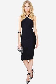 The hottest black cocktail dress featuring halter neckline, strap detail, and textured fabric. Un...