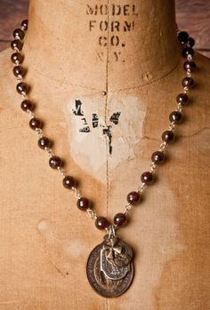 Shannon Koszyk Jewelry - Garnet Immaculate Mary Necklace Would love with gold wire, any color bead about that size, gold pendant...