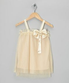 Both timeless as well as trendsetting, this beautiful dress echoes back to the rollick of the Roaring '20s with its slip-on shift silhouette, pleated overlay, dainty straps and satin bow.