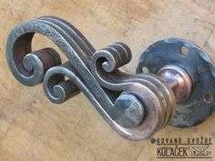 Door handle, wrought iron. Kvaka od kovanog ovozdja. Kolacek 1897