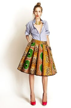 Stella Jean S/S 2012, blue button down shirt and batik pleated circle skirt.