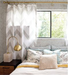 i dont know why, but i'm completely fascinated with this color scheme. love those chevron drapes!