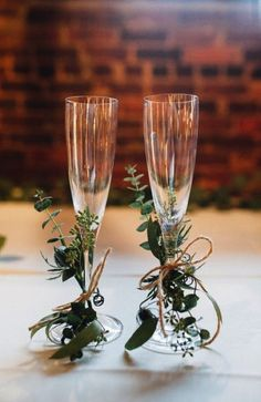 Incorporate more foliage by tying small sprigs of greenery to glasses and place names. Image: Pinterest