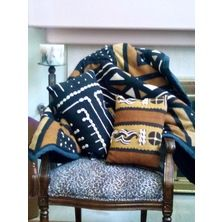 Mud Cloth is just another unique African fabric. The heavy giant size throw and two pillows are available on 8 week delivery. The fabric is imported from Africa and all pieces are hand embellished in America. $750.00