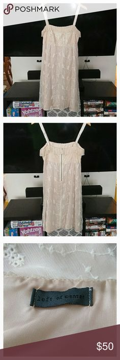 "🎁SALE🎁Anthro Left of Center Silk Dress Beautiful silk dress from Anthro in excellent condition. Brand is Left of Center. Size 4. Features an empire waist with delicate cream/ivory silk and lace. This dress is perfect for any upcoming holiday parties and NYE celebrations! Pair with your favorite cardigan or wear on its own. From a smoke free home!! I'm accepting offers on this dress. If you love it, please don't hesitate to ask!!!  **APPROXIMATE**  Empire Waist: 14"" Armpit to Armpit: 15""…"
