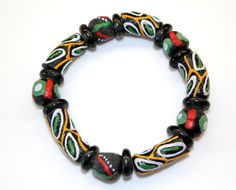 This stretch cord bracelet includes all recycled glass beads made in Ghana, West Africa: painted black beads, black disc spacers. All proceeds go to help build the computer lab at SDA School in Ankaase. Size: small (7 inches around). $20