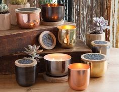 Beautiful candles in metallic reusable bowls.