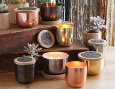 Beautiful candles in metallic reusable bowls.