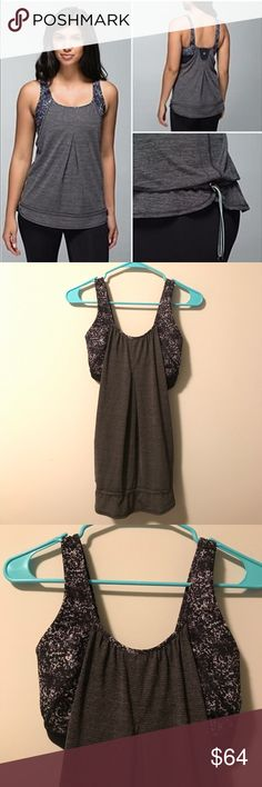 🔥RARE🔥 Lululemon Rest Less Bra Tank Rare Lululemon Rest Less Tank, size 4. No longer in production. Heathered gray loose fit tank with built in green and white paint splatter bra. Drawstring at the bottom of the tank for an optional, more body-hugging fit. Perfect condition. lululemon athletica Tops Tank Tops