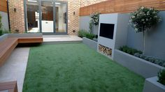 modern garden designer london artificial grass hardwood seat fireplace hardwood slatted cedar screen trellis mayfair london