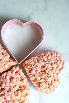 rice krispies treats get so much cuter with the addition of pink food coloring and a heart cookie cutter