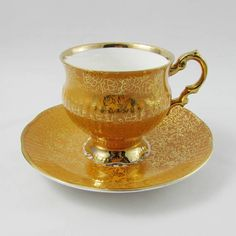 Beautiful tea cup and saucer made by Elizabethan. Tea cup and saucer are orange with gold chintz. Gold trimming on cup and saucer edges. Excellent condition (see photos). Markings read: Elizabethan Fine Bone China Made in England Please bear in mind that these are vintage items and