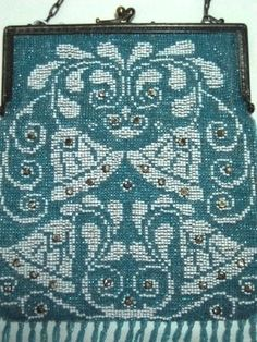 Antique German Beaded Purse. The beadwork shows the early 1900's Art Nouveau influence with it's curling details but those bright white wedding bells embellished with 34 bezel set rhinestones are what makes this purse so very unique.