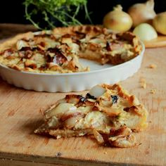 Delicious tart with soft onion, cheese and fresh thyme