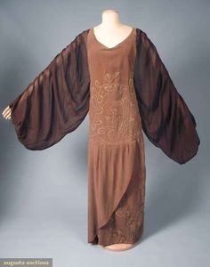 LONG AUTUMN DINNER DRESS, LATE TEENS floor length cocoa brown brushed velvet jumper, pale olive leaves & fan shaped flowers embroidered on bodice & tulip shaped skirt, brown chiffon voluminous Renaissance style sleeves & back bodice.ge