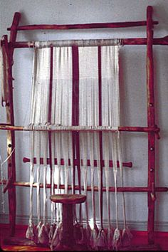 Weaving on a warp-weighted loom.