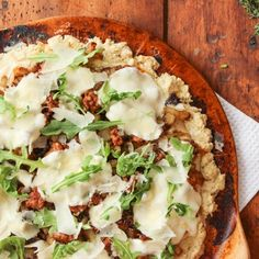 This delicious pizza features potato, sausage, and onion with a creamy alfredo base.  Whip it up and dish it out!