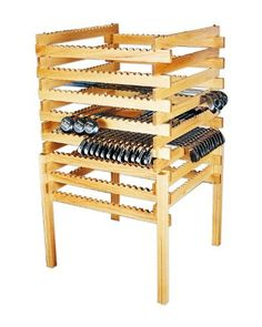 """FA Edmunds 4 Sided Stack Rack -Medium Oak by FA Edmunds. $603.55. 288 Club four sided stack rack.. Package Dimension : 58""""H x 36""""W x 36""""D.. A space saving display that holds up to 288 clubs. It is versarile enough to also hold utility wedges, umbrellas, putters, ball retrievers or 16 complete sets of clubs. Free standing, this display allows for 4 sided merchandising. This is the perfect end cap or center shop display. Available in Natural Oak, Medium Oak or Dark Oak stain."""