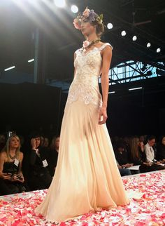 OK, actually, it was a runway, but there were silk rose petals, and the wedding dresses Claire Pettibone, the bridal designer Mrs. Mark Zuckerberg wore for her ceremony, showed today at Bridal Market were sososo ethereal. I felt like I was in a secret garden!