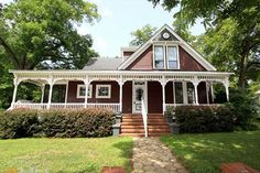We're smitten with the wraparound porch on this Folk Victorian delight, which dates back to 1887.