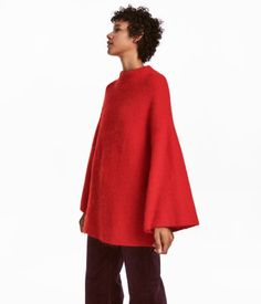 Red. Long, wide-cut, rib-knit sweater in a soft mohair blend. Wide ribbing at neckline, dropped shoulders, and long, wide sleeves.