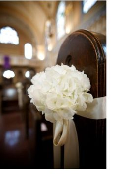 Blue and white flowers with silver ribbon? Use on Mon reserved pews?