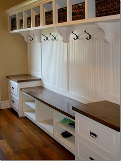 detail - seatig w drawers, shelves at top. like hooks; does not make use of middle space