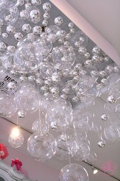 Instead of paying thousands, make your own bubble chandelier for the bathroom (ocean theme) for half the cost!