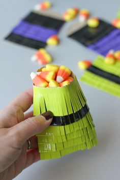 What a FUN way to make favor bags.  Use small brown paper bags and make fringes using colored duct tape