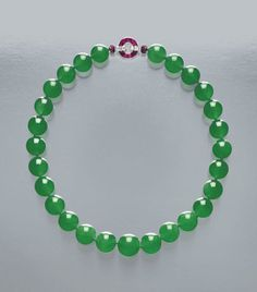 The Hutton-Mdivani Necklace featuring 27 Qing jadeite beads with a beautiful Art Deco ruby and diamond clasp created by Cartier in 1933. It was presented as a wedding gift to Barbara Woolworth Hutton when she married Prince Mdivani of Georgia. Considered the greatest jadeite bead necklace and expected to fetch in excess of $12.8 million at Sotheby's Magnificent Jewels and Jadeite Sale on April 7th, 2014.