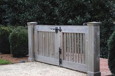 The walkway is crushed pea gravel compacted with sand over poured concrete. I don't care for soft gravel surfaces where the heels sink in. Driveway Gate, Fence Gate, Walkway, Cedar Gate, Garden Gates And Fencing, Country Fences, Double Gate, Entrance Gates, Yard Gates