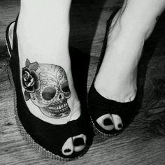 Sugar skull foot tattoo