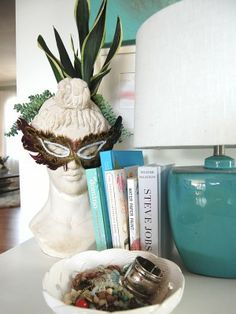 I oddly like the bust planter with a mask.
