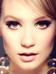 Recreate this gorgeous look by applying a cream blush to the cheeks for a subtle finish and using a pale pink pencil on the lips. Apply thick false lashes for drama and apply mascara to the lower lashes to keep the look wide-eyed and dramatic. Groom brows with a brush. Et voila - a beautiful evening look.