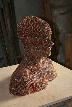 coin sculpture.  now i know what to do with all my pennies.  i bet this piece weighs more than i do.