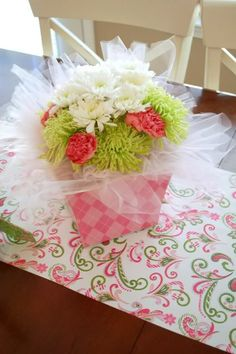 Flowers in a decorative box with tulle netting.