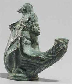 A ROMAN BRONZE OIL LAMP  CIRCA 1ST-2ND CENTURY A.D.
