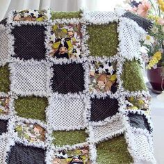 Baby Rag Quilt Cute Cows combined with green, black and white. A fun baby quilt for the farm theme nursery.