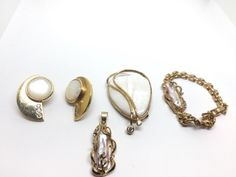 LOT INCLUDES A STERLING VERMEIL SHELL BROOCH/PENDANT WITH MATCHING EARRINGS AND AN 18K GOLD PLATED PEARL PENDANT AND BRACELET SET.