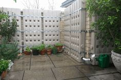 """Rain water collection system. This can be a """"two-fer"""" because it allows the transfer of heat from the house to the outside and the outside to the house walls to keep the interior a comfortable temperature. http://www.cleanairgardening.com/rain-water-storage.html"""