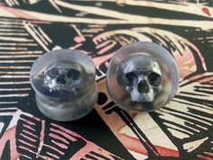 Clear Plugs With Silver Skull - 0g 8mm - 3/8 9mm - 00g 10mm  - 7/16 11mm - 1/2 12mm - 9/16 14mm - 5/8 15mm - 3/4 19mm - 7/8 22mm - 1 25mm by OjingoStudio on Etsy https://www.etsy.com/listing/166584881/clear-plugs-with-silver-skull-0g-8mm-38