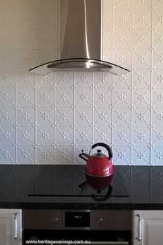 "This stunning splash back was created from the pressed metal ""Clover"" design. Large panels make for a quick installation job. For more photos see: http://www.heritageceilings.com.au/clients-projects/chevers-pressed-metal-splash-back.php"