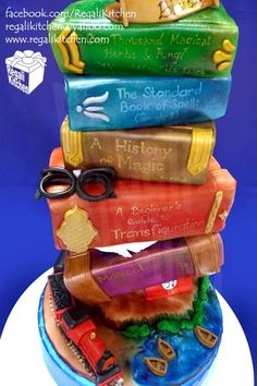 Harry Potter cake with glasses for a lucky 3 year old | Topsy Turvy Dark Chocolate Cakes with Light Caramel Frosting. Each book is a cake and all decorations are edible, by Chef JB Cada and Stephanie Santos