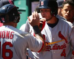 St. Louis Cardinals Team Photos - ESPN St. Louis Cardinals Kolten Wong, left, and Yadier Molina congratulate each other after scoring against the Cincinnati Reds in the fifth inning of a baseball game, Sunday April 12, 2015, in Cincinnati. (AP Photo/Tom Uhlman)