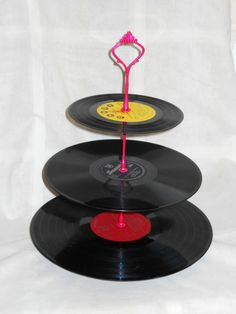 This fun vinyl record cake stand looks great but is easily DIY-able. Retro 1950s kitsch wedding inspiration.